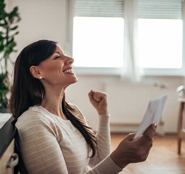 Woman With Pay Check Happy